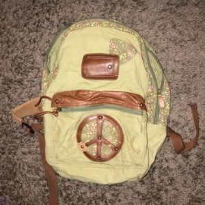 army green and leather bookbag